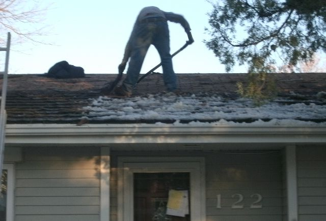 A total roof replacement, with a woodshake tear off and replaced with a hail resistant class 4 shingle